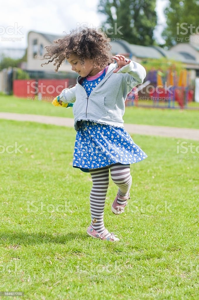 Child ( 4-5 ) Goes Round in Circle stock photo