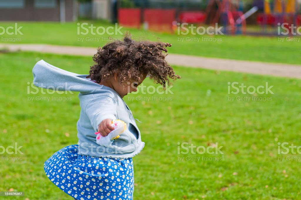 Child ( 4-5 ) Going Round in Circle stock photo