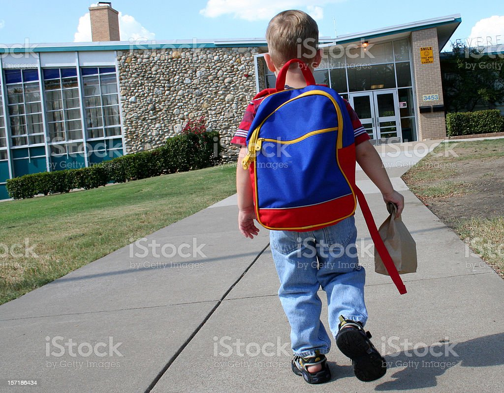 Child Going to School in Primary Colors stock photo