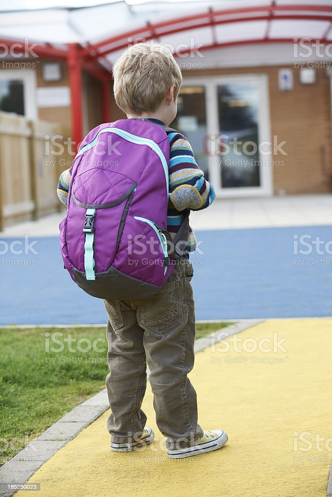 Child Going To School Wearing Backpack stock photo