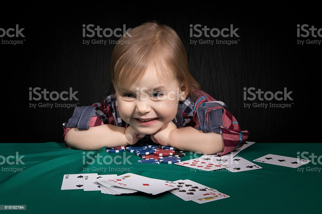 Child grabbed the poker chips stock photo