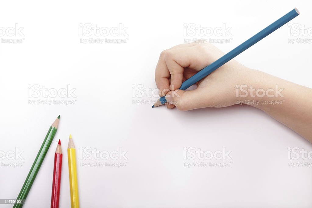 Child hand draws a blue pencil stock photo