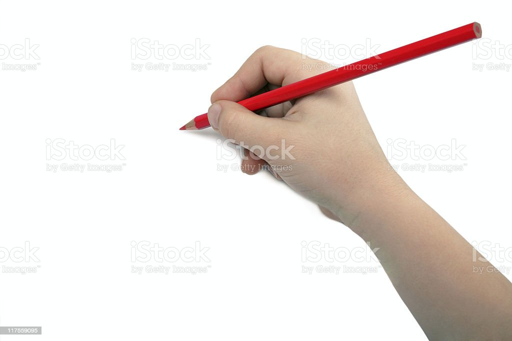 Child hand draws a red pencil stock photo