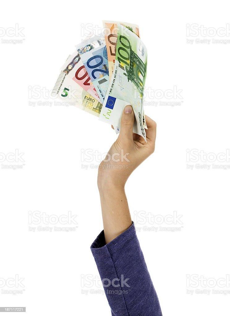 Child hand holding euros royalty-free stock photo