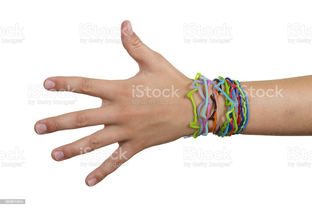 Child hand wearing silly shaped rubber band bracelets on arm royalty-free stock photo