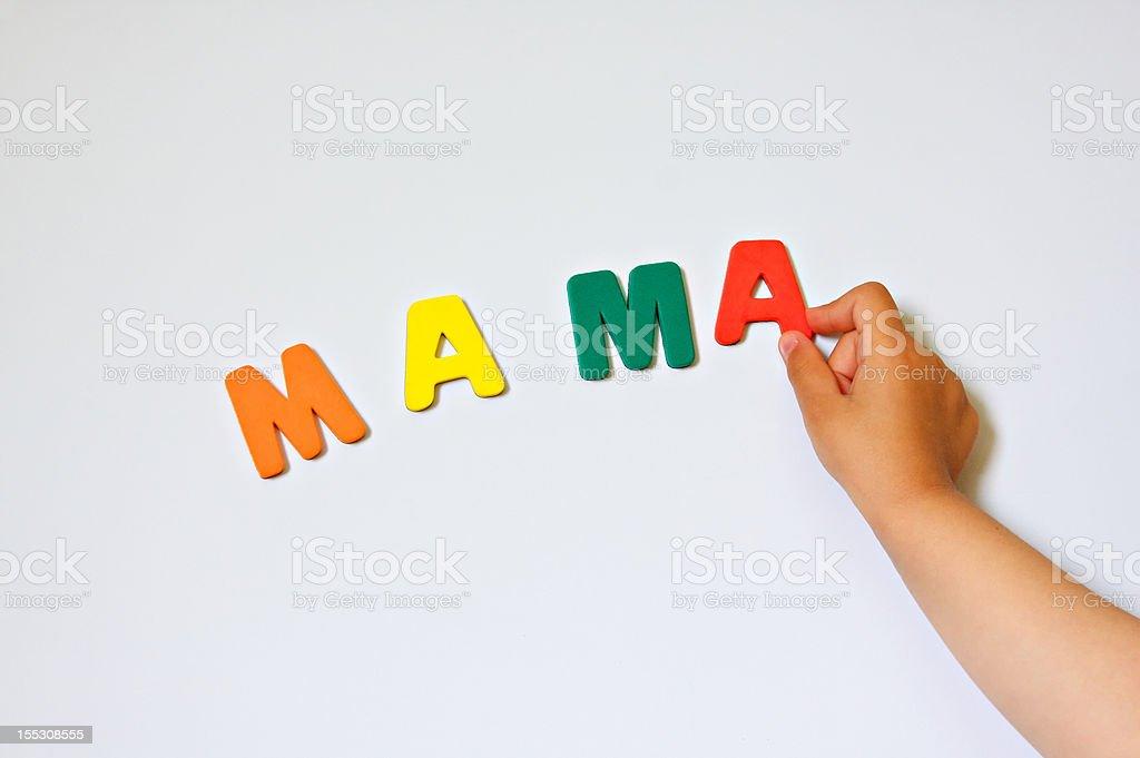 Child hand writing word Mama royalty-free stock photo