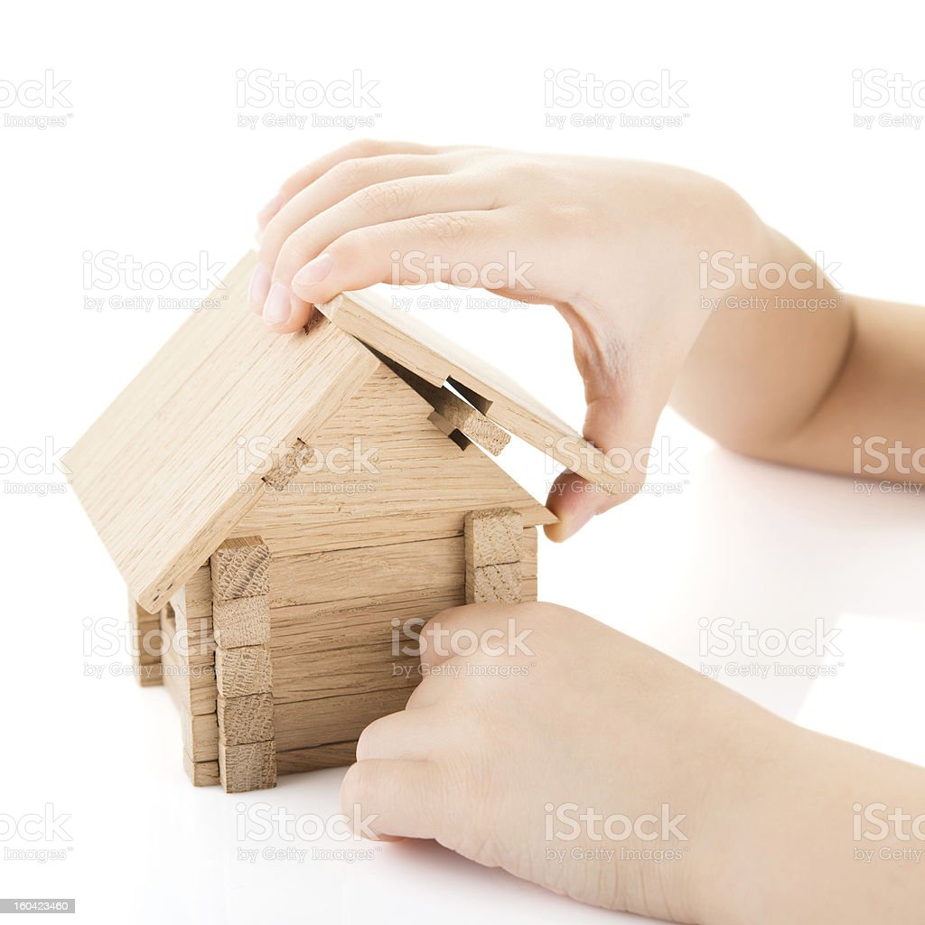 Child hands build a house royalty-free stock photo