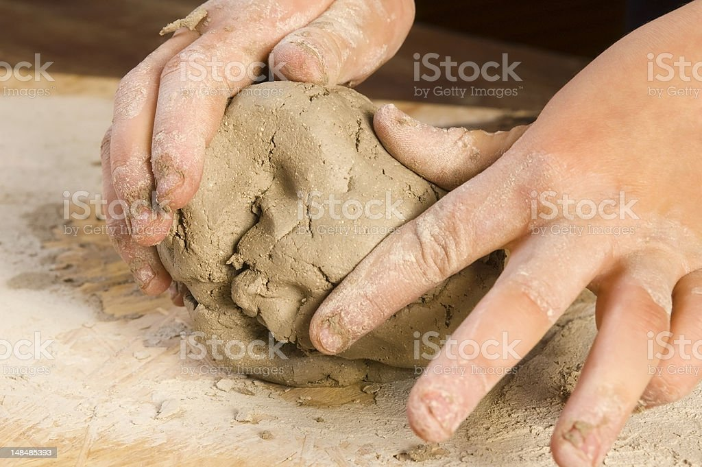 Child hands of a potter stock photo