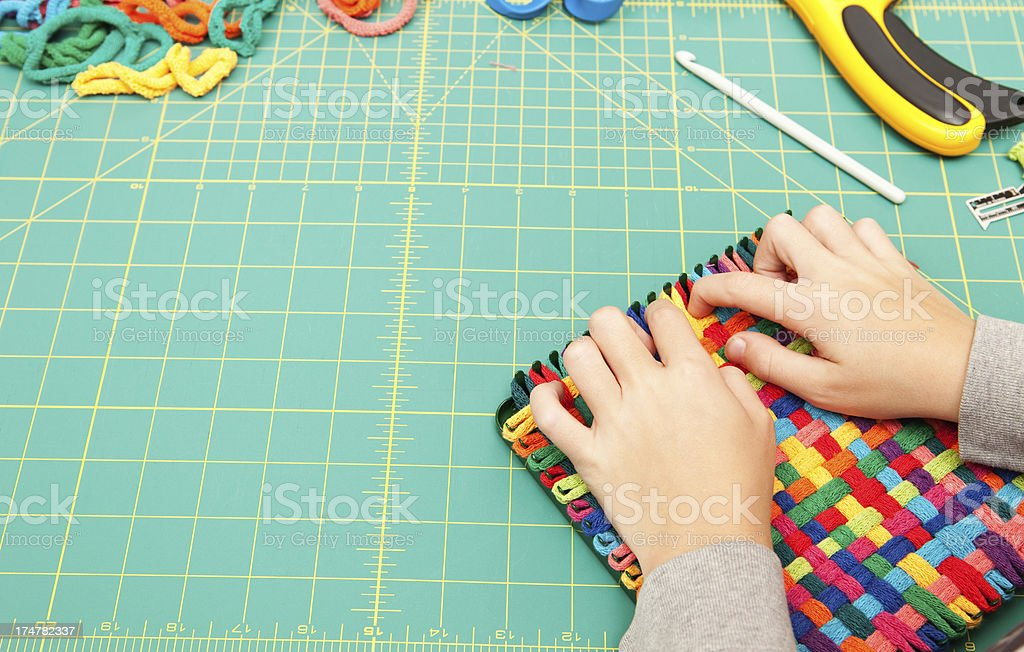 Child Hands Working on Weaving Project stock photo