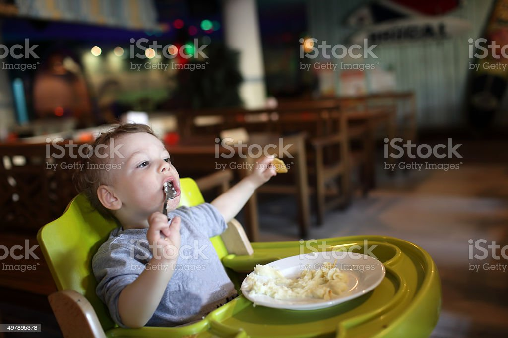 Child has a lunch stock photo