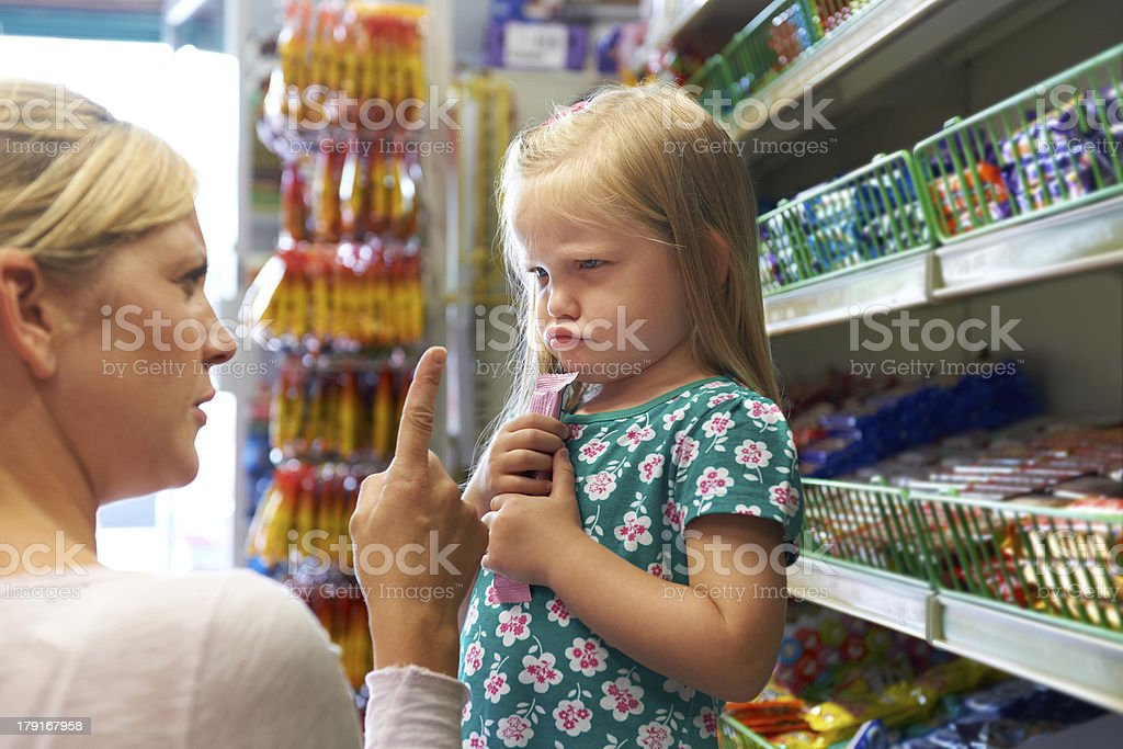 Child Having Arguement With Mother At Candy Counter stock photo
