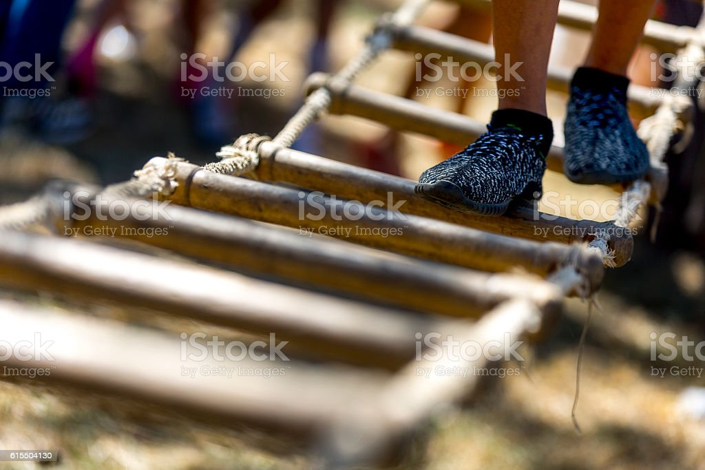 Child  having fun at outdoor playset stock photo