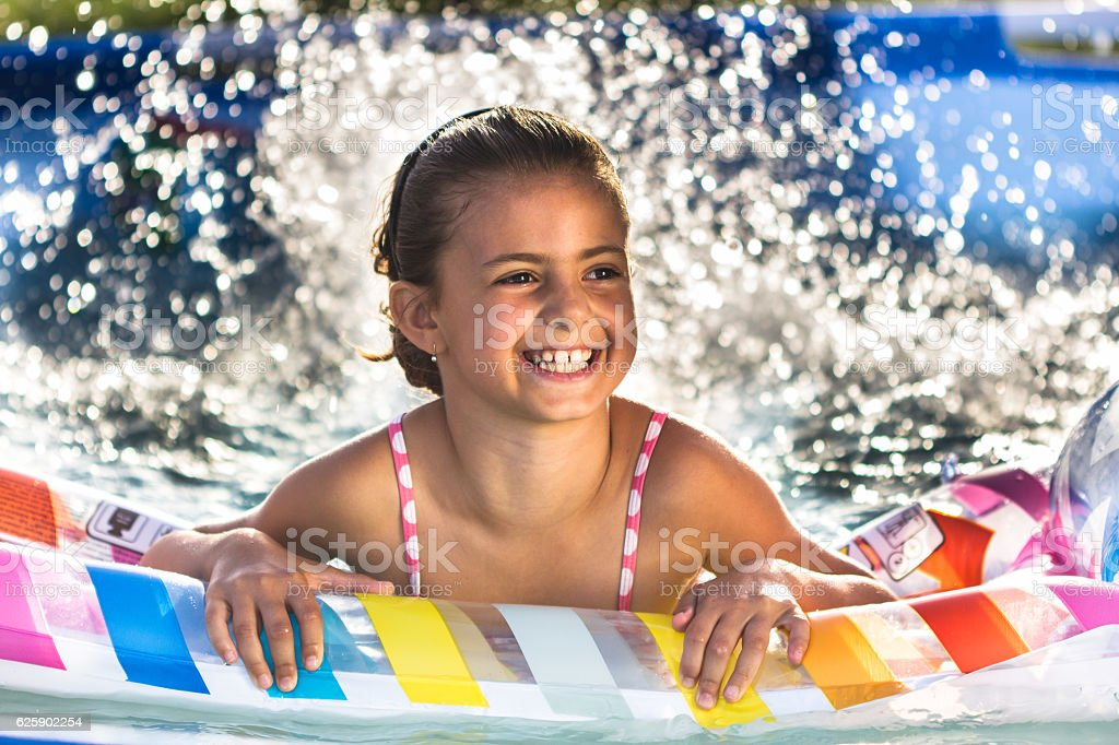 Child having fun in swimming pool.  Kid playing outdoors royalty-free stock photo
