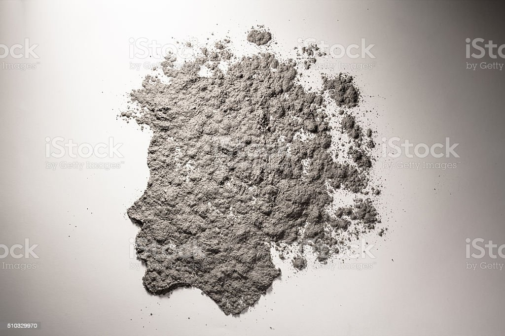 Child head silhouette with scattered hair made of ash stock photo