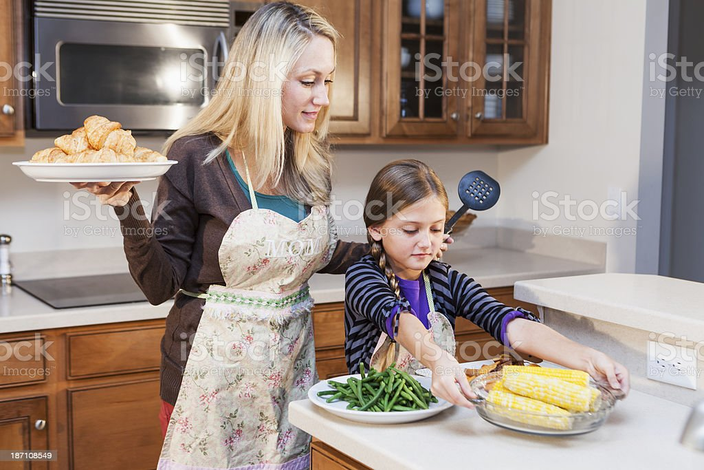 Child helping mother in kitchen royalty-free stock photo