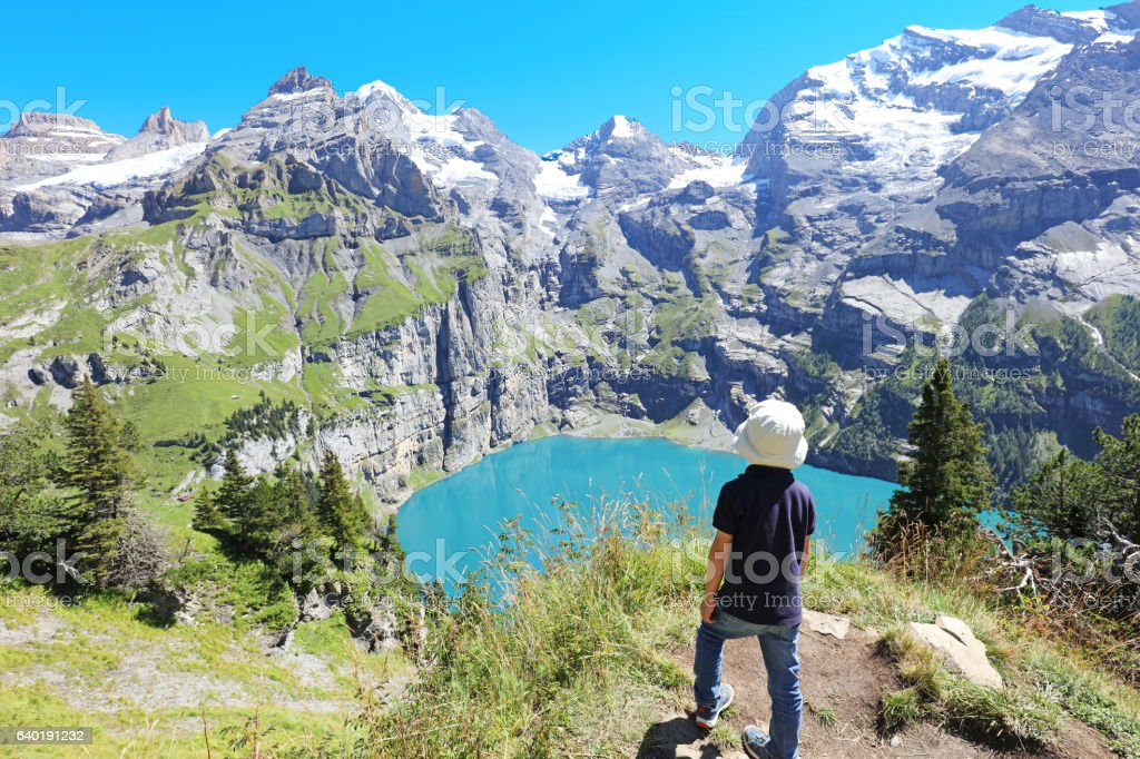 Child Hiking in the mountains in Switzerland stock photo