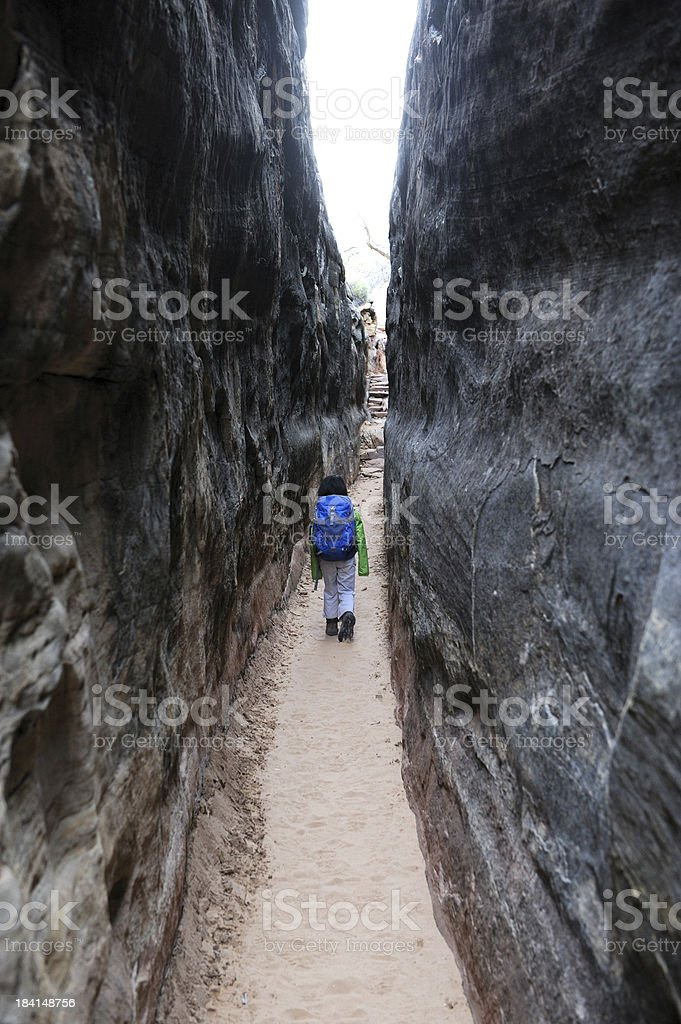 Child Hiking Narrow Trail Between Rock Walls royalty-free stock photo