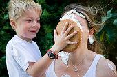 child hits mummy with custard pie