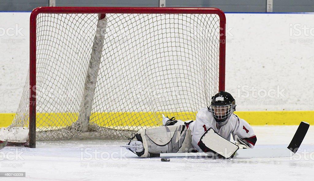 Child hockey goalie making a save stock photo