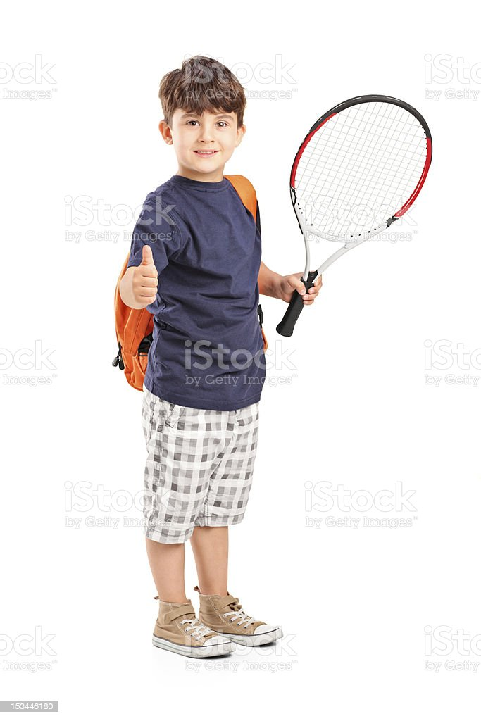 Child holding a tennis racket and giving thumb up stock photo
