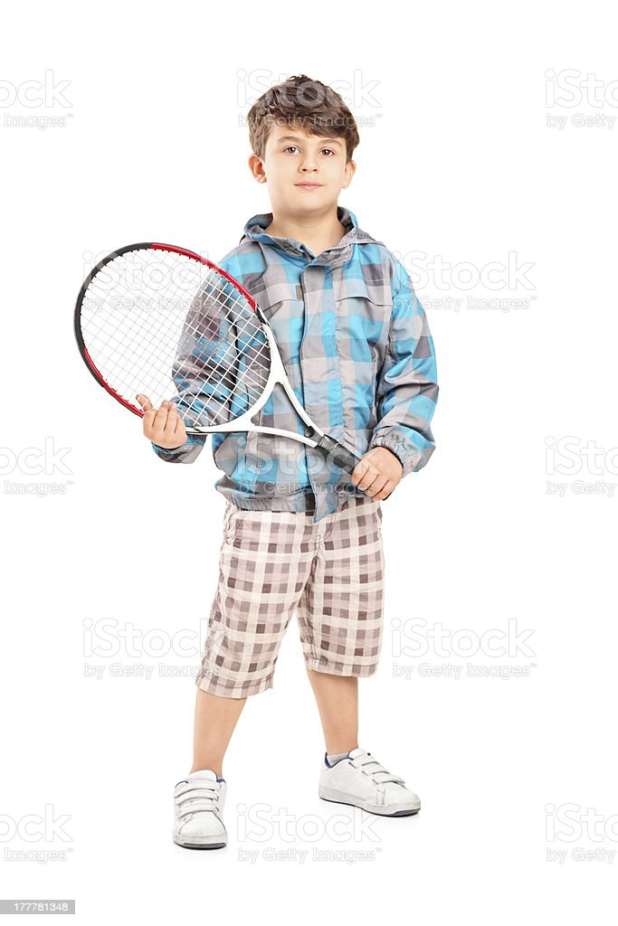 Child holding a tennis racket stock photo