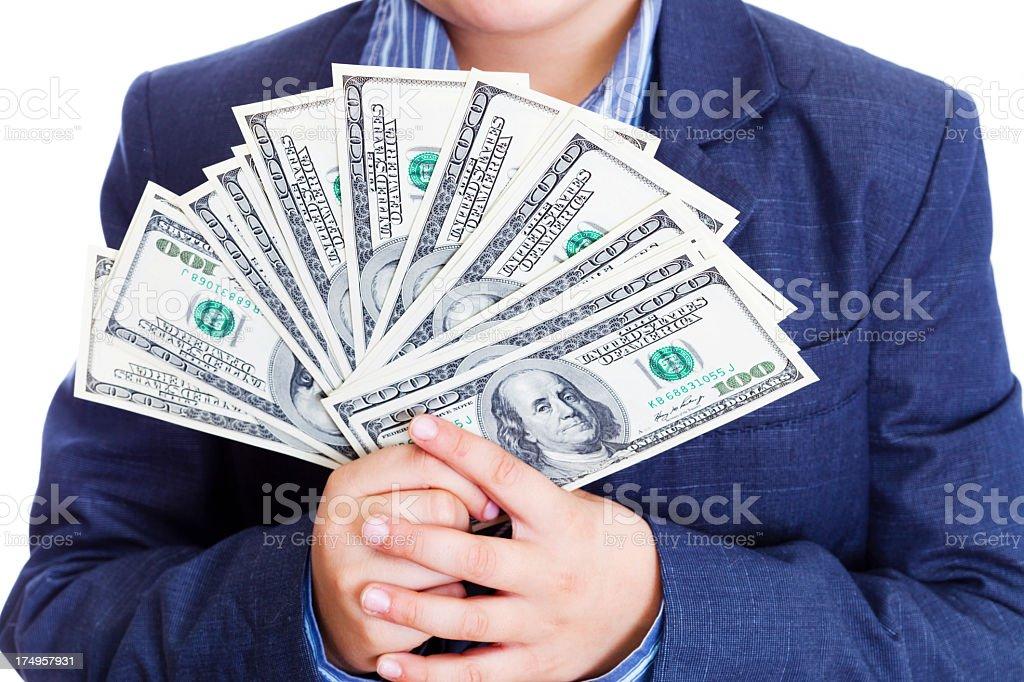 Child holding American $100 bills royalty-free stock photo