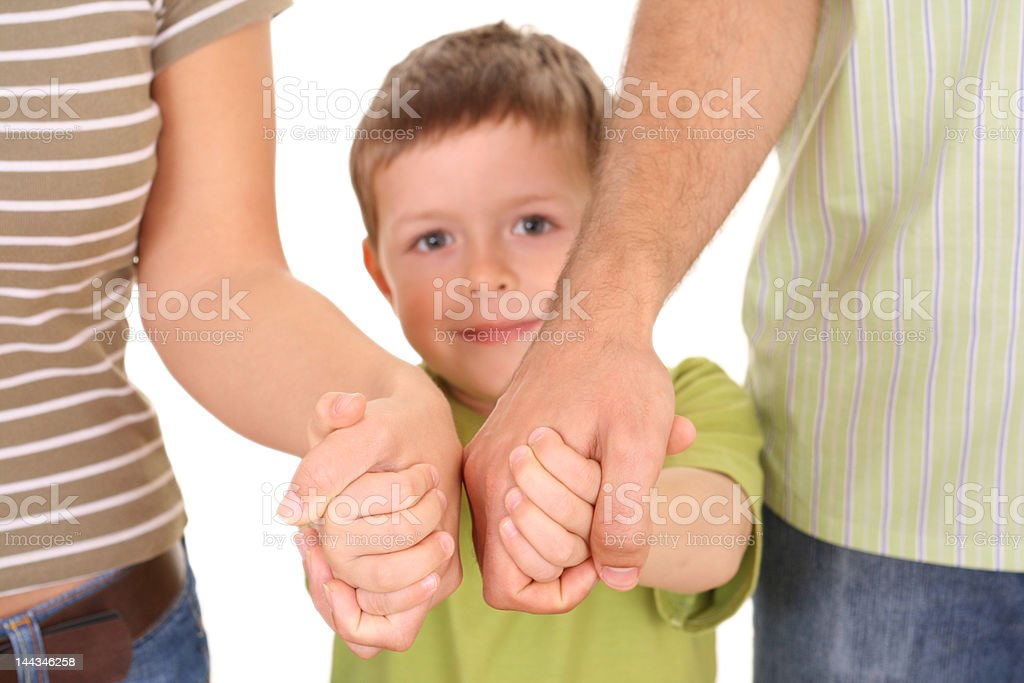 A child holding both his parents hands and feeling safe royalty-free stock photo