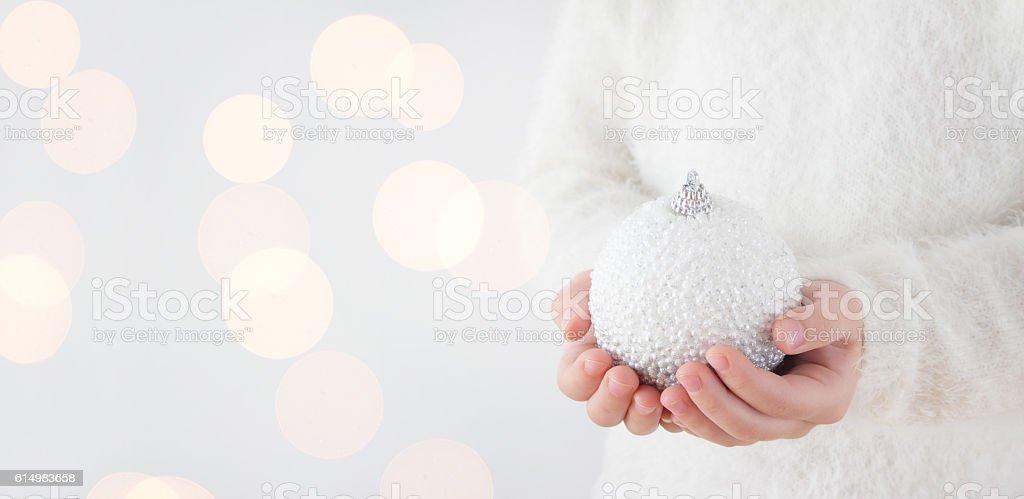child holding christmas ball stock photo