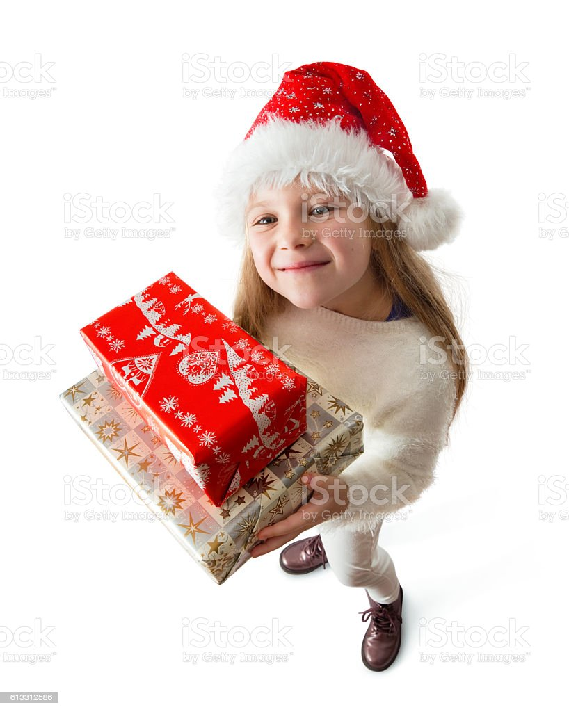 child holding christmas gifts stock photo