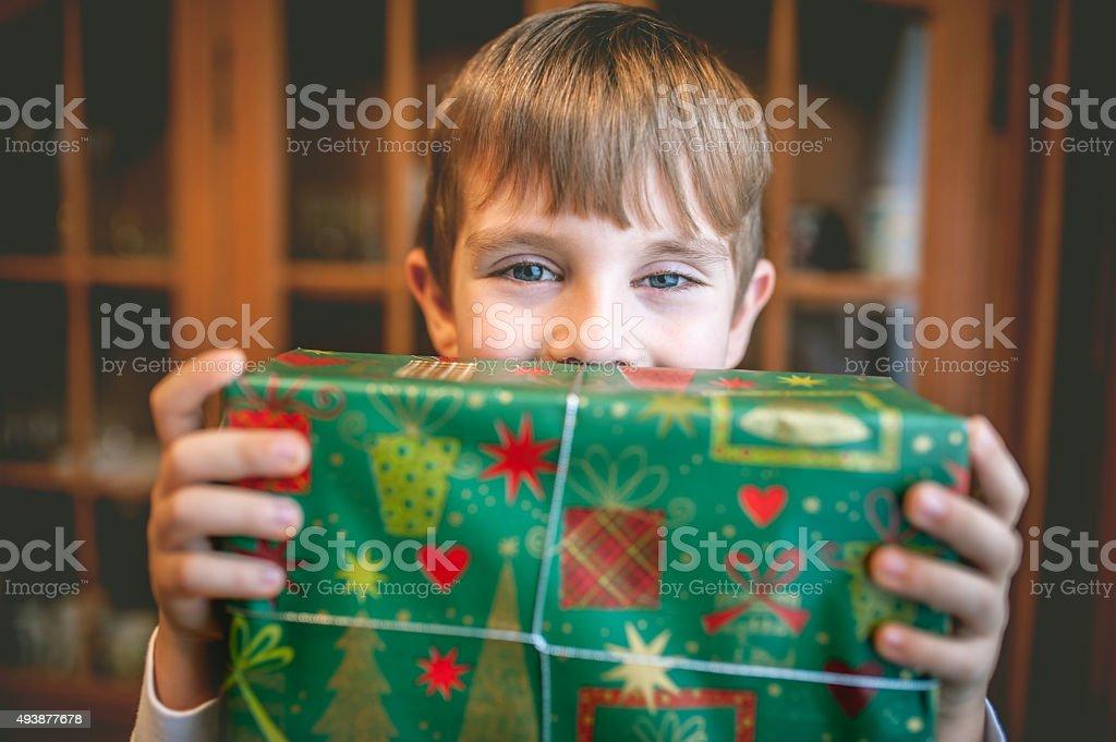 Child Holding Christmas Present stock photo