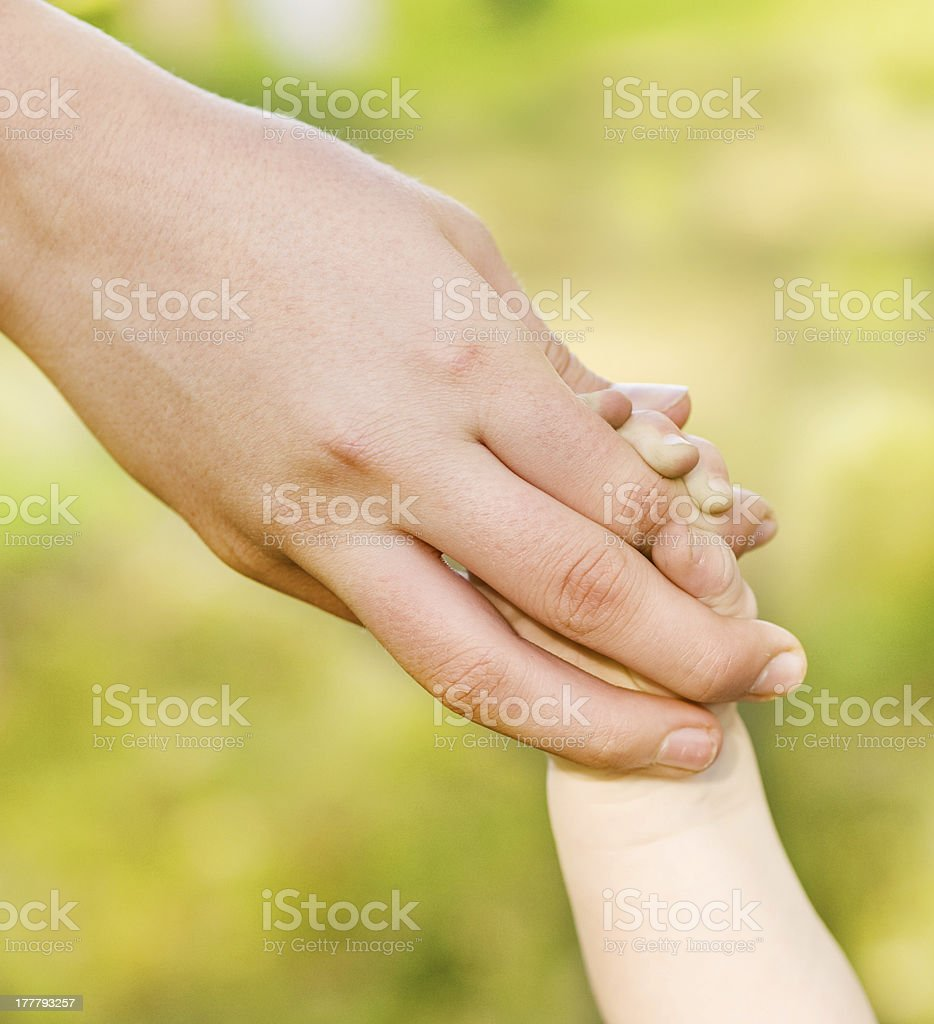child holding fingers of mother royalty-free stock photo