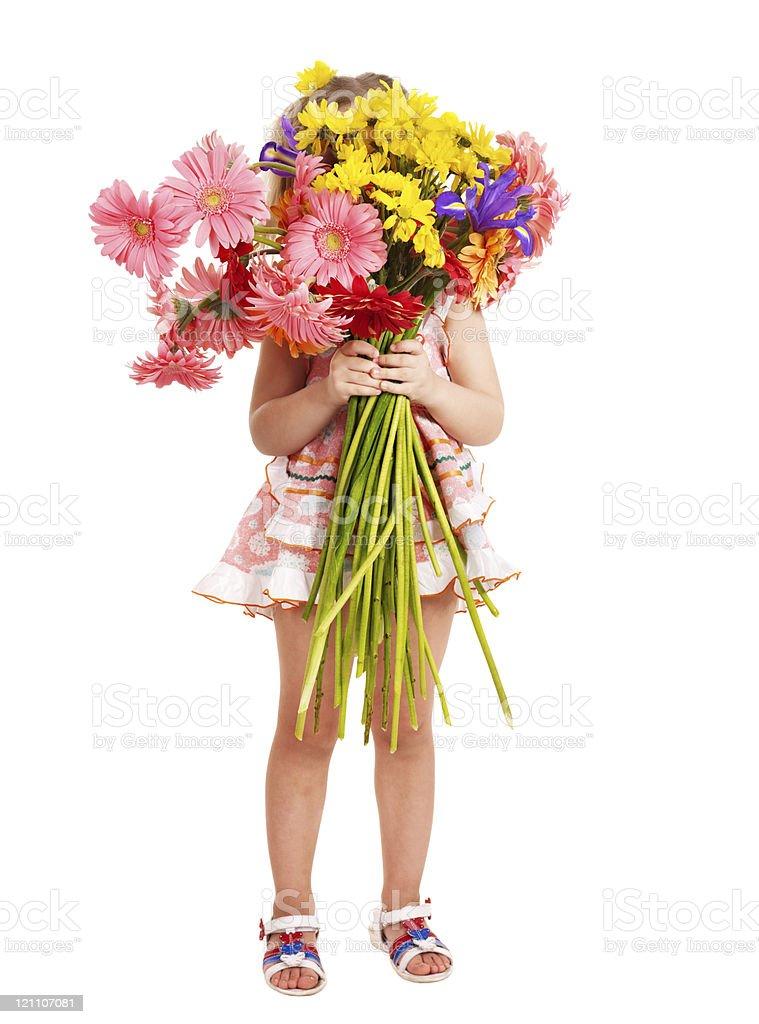 Child holding flowers. stock photo