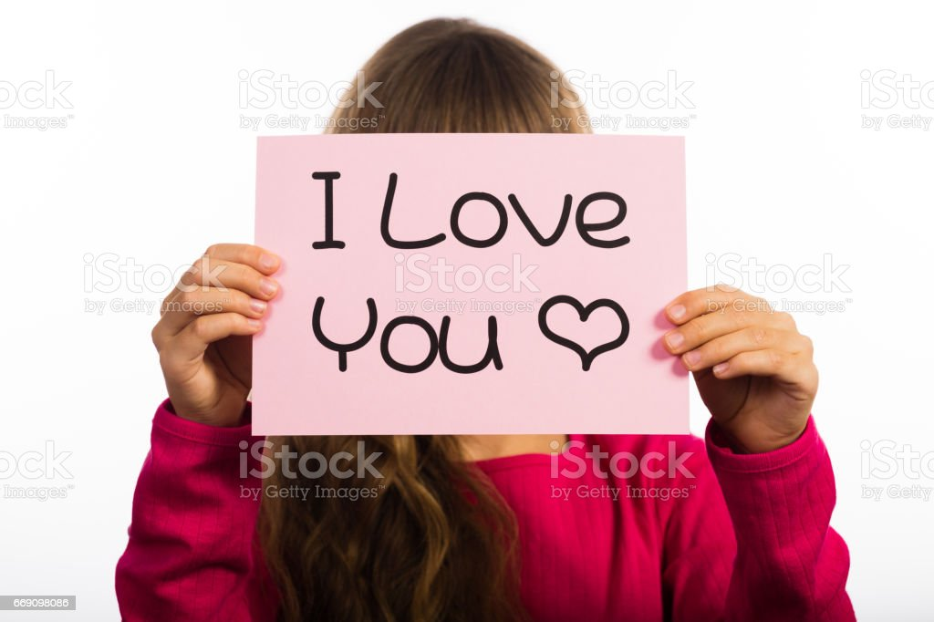 Child holding I Love You sign stock photo
