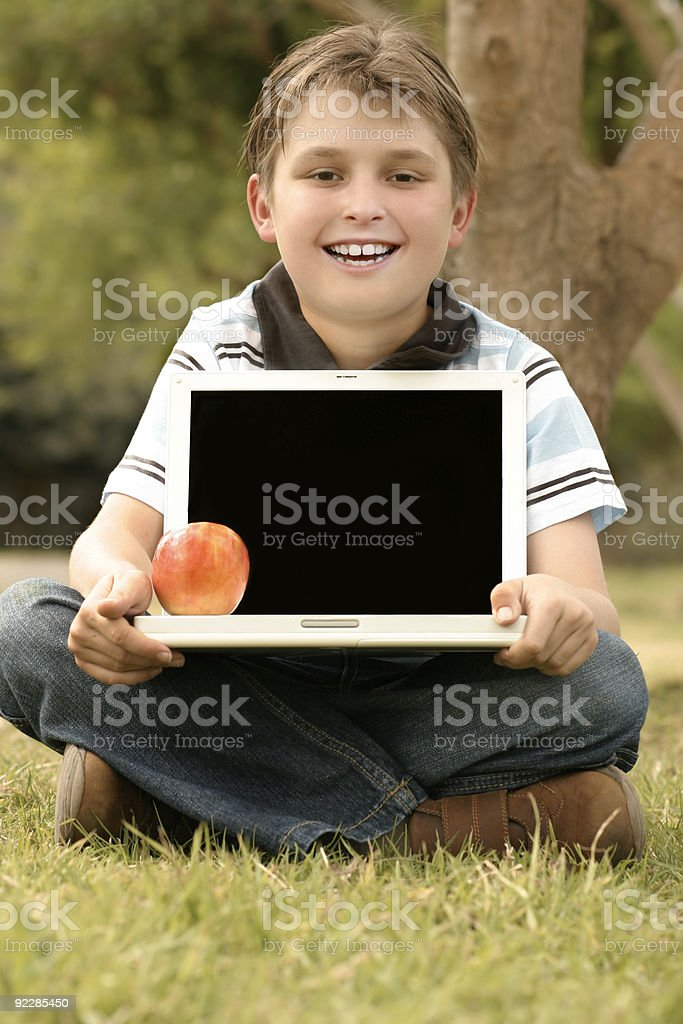 Child Holding Laptop with blank screen royalty-free stock photo