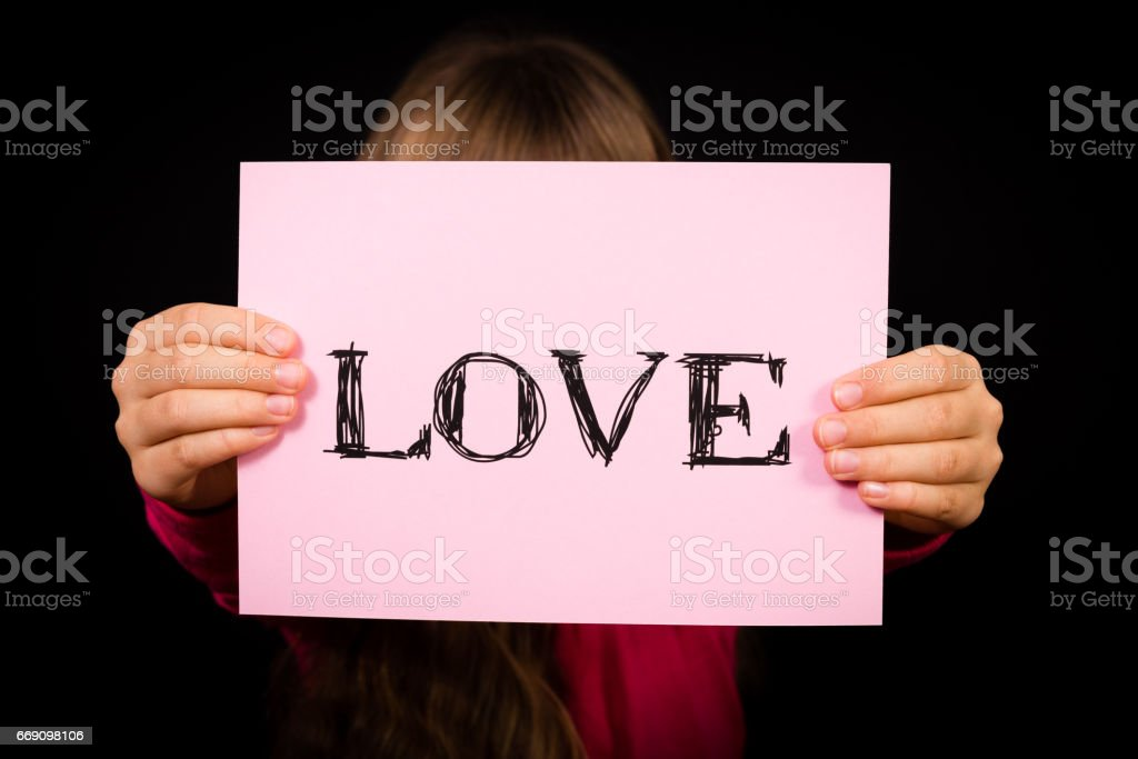 Child holding Love sign stock photo