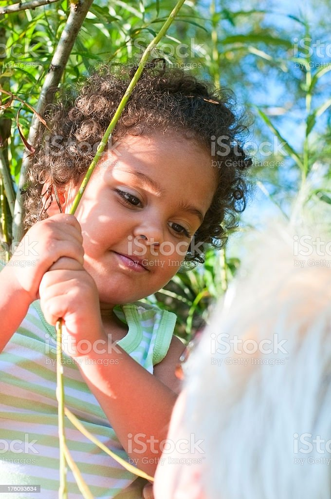 Child (3-4) Holding on Branches, Vertical royalty-free stock photo