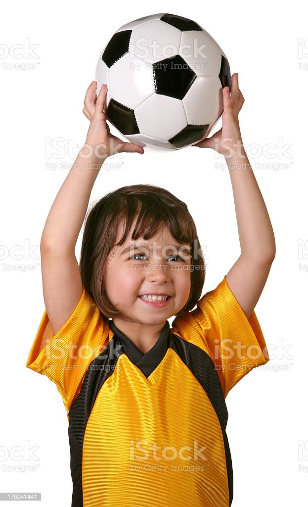 Child holding soccer ball above her head royalty-free stock photo