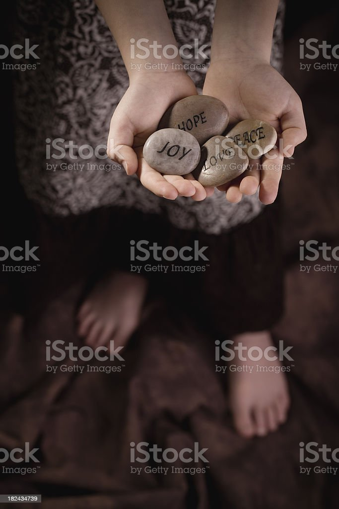 Child holding Stones of Faith royalty-free stock photo