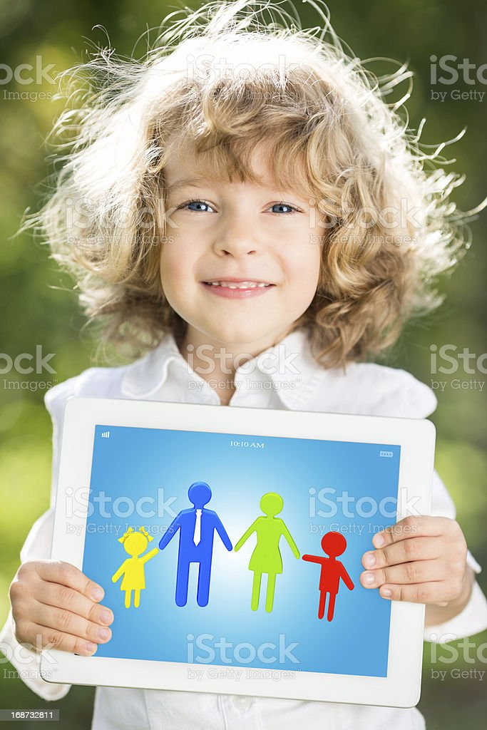 Child holding tablet PC royalty-free stock photo