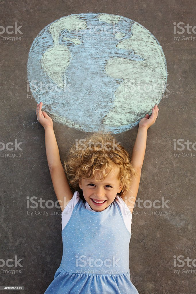 Child holding the globe stock photo