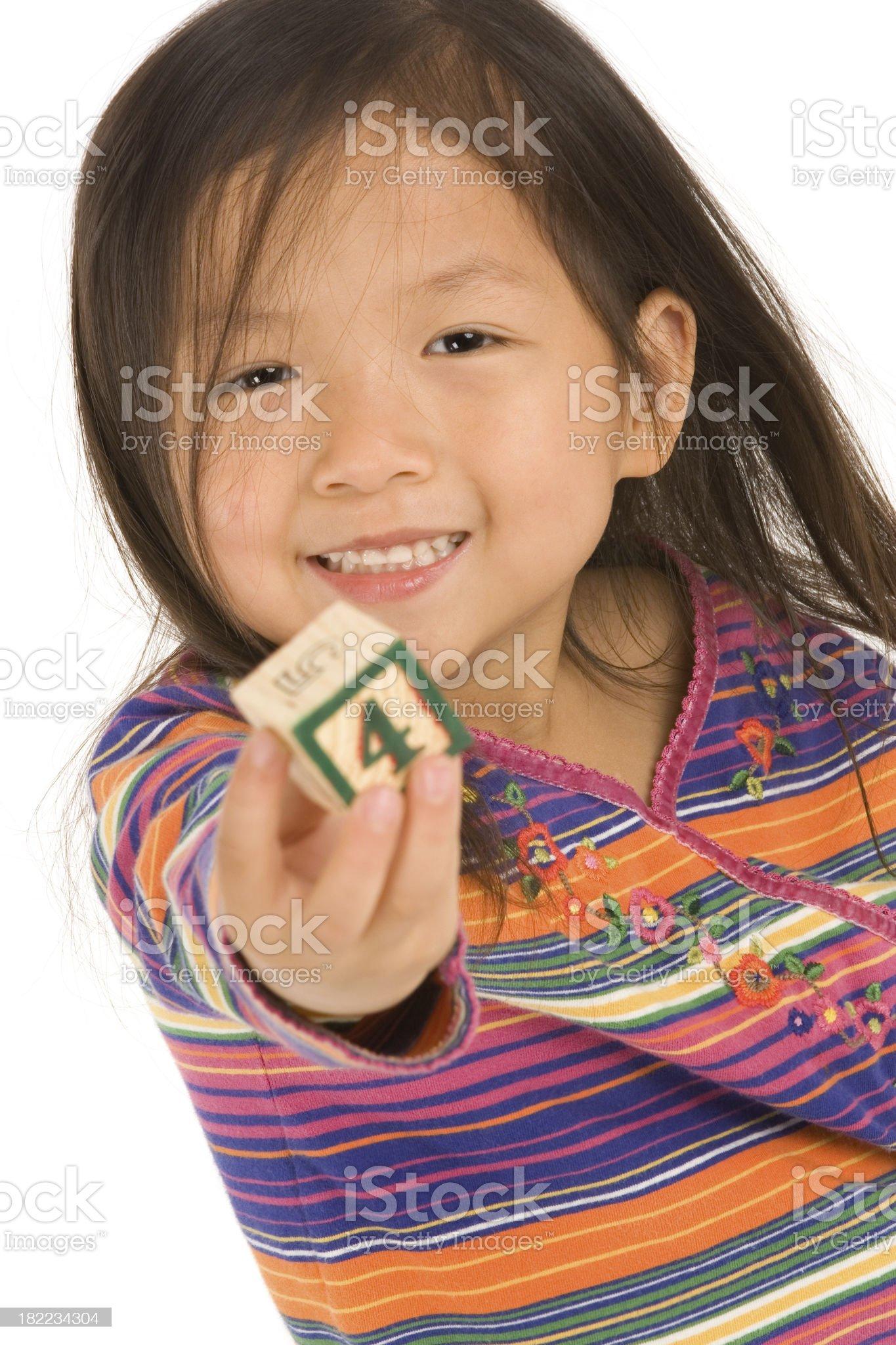Child holding up toy block royalty-free stock photo