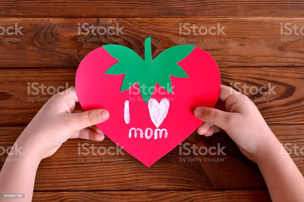 Child holds greeting card in his hands stock photo
