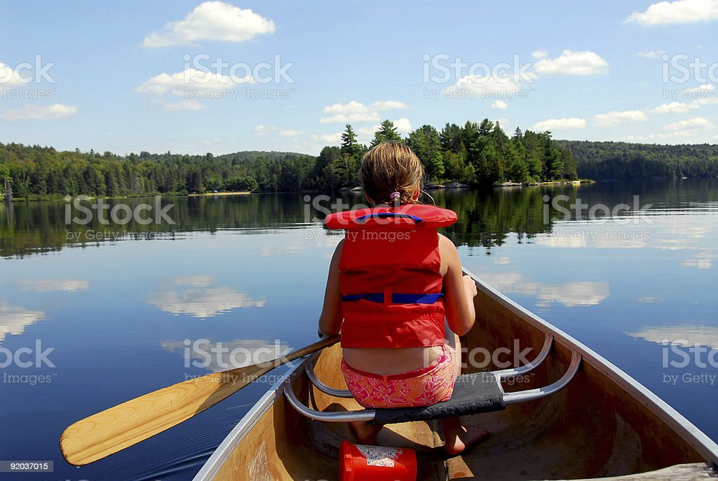 A child in a canoe in the water royalty-free stock photo