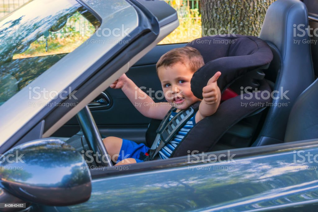 Child in a car child seat stock photo