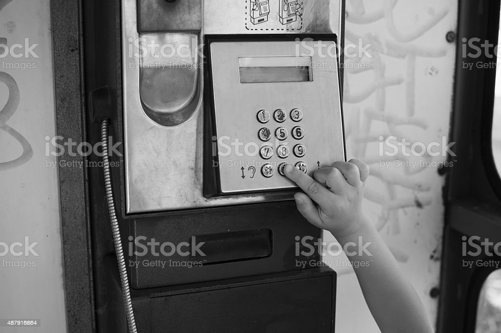 Child in a phone booth stock photo