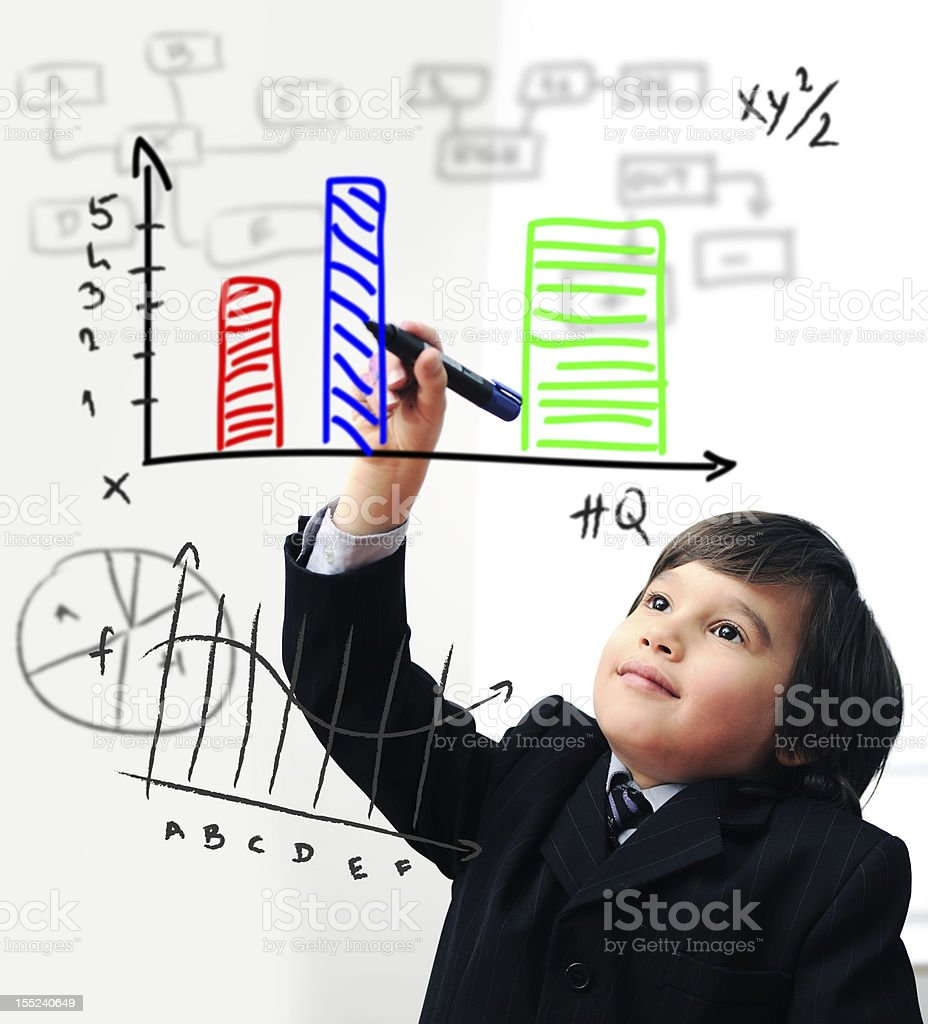A child in a suit drawing a graph stock photo