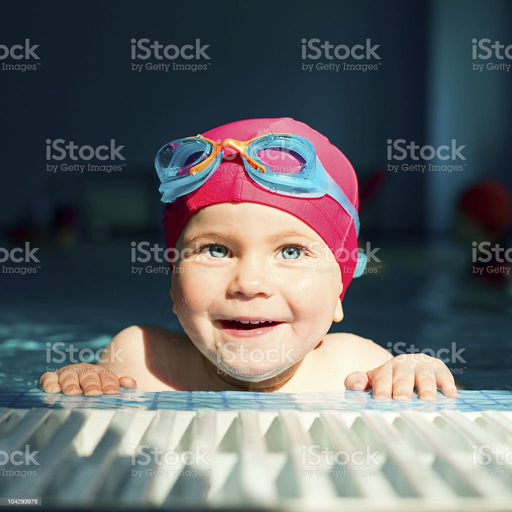 Child in a swimming pool royalty-free stock photo