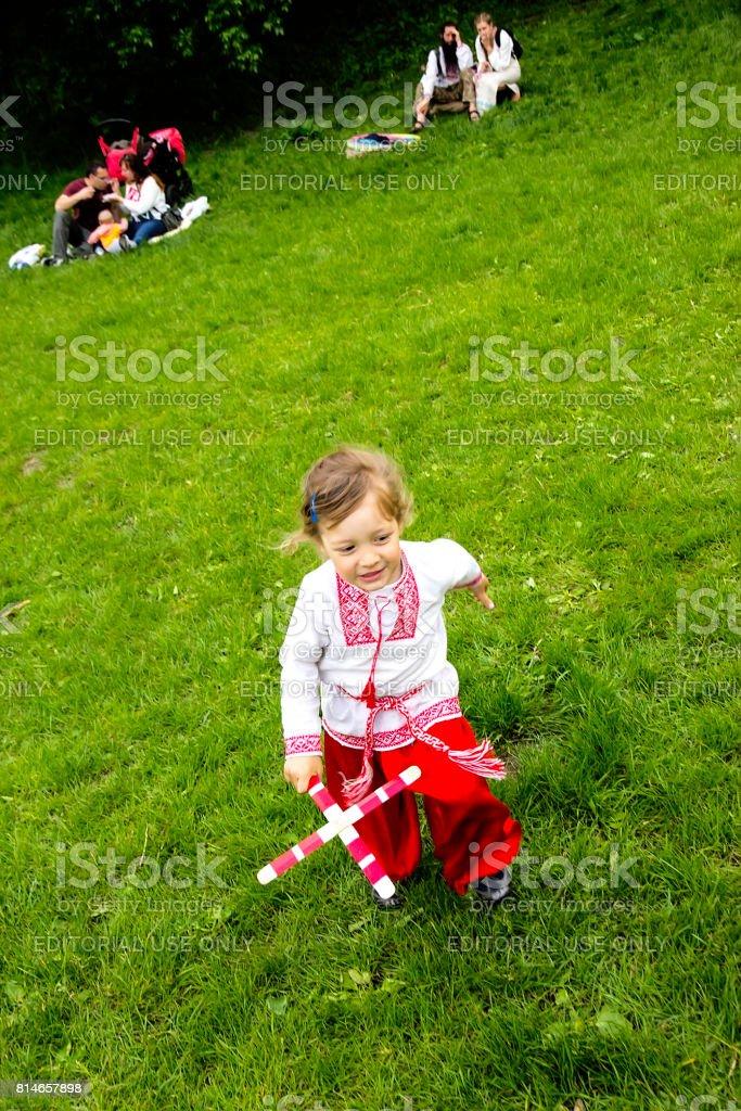 A child in a Ukrainian national costume runs stock photo