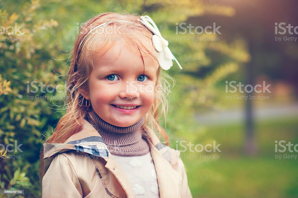 Child in autumn after rain stock photo