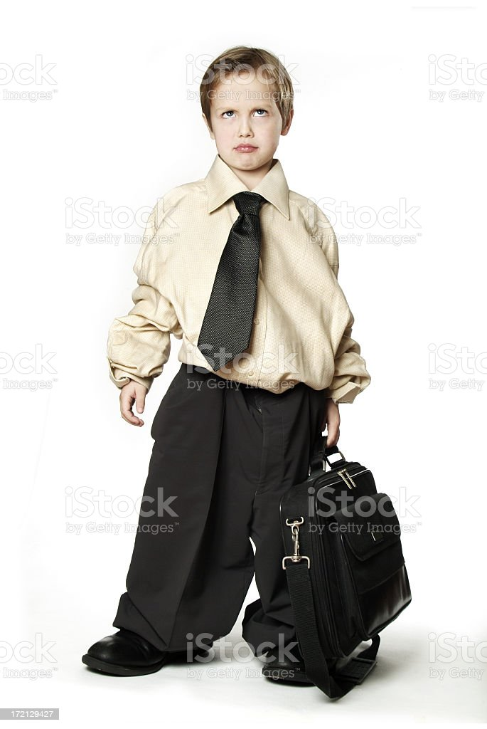 Child in baggy business suit and briefcase stock photo